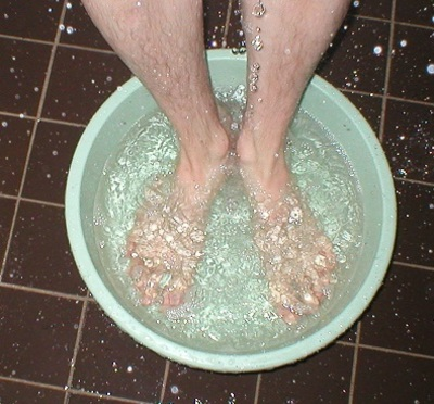 Man Soaking Feet in Basin