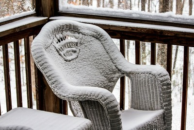 Wicker chair in snow